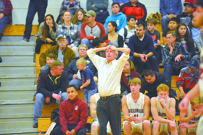 Okanogan coach Mike Carlquist reacts to action against Omak on Jan. 9.