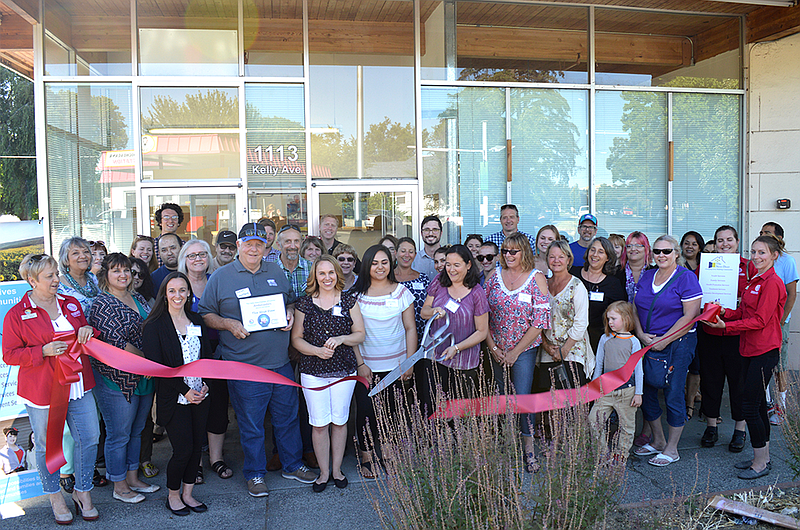 Delicieux Janet Hamada, Executive Director Of The Next Door Inc., Cuts The Ribbon Of