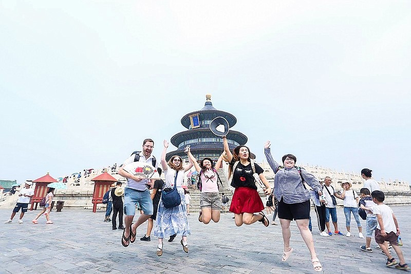 Dan Kenealy,  far left, and his fellow International Music School students having some fun in front of the entrance to the Temple of Heaven in Beijing, China, this summer.