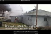 Firefighters extinguish a fire at 4509 Chenowith Road Tuesday morning, Jan 21, 2014. Video Mark B. Gibson
