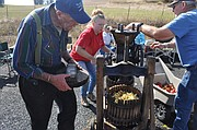 About 50 people participated in the third annual Tahoe QRU Apple Cider Pressing fund-raiser, held Saturday morning, Oct. 1, 2016, on Leitch Creek Road outside Kooskia. Participants combined a range of apples — including red and golden delicious to McIntosh and gala — and elbow grease to press out smooth, sweet cider. The event raised $156 for the volunteer emergency medical response organization.
