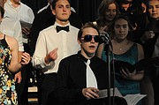 """Grangeville High School's Varsity Blue Choir performs in the May 8 Pops concert at GHS. The choir was under the direction of Mr. Phil Golde. Here, the group sings """"The Lions Sleeps Tonight,"""" featuring junior Kelsey Pilant."""