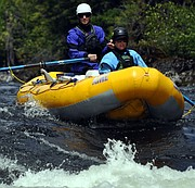 Lochsa River Madness event 2013: This rafting group makes it successfully through the rapids.